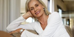 Fotolia Close Up Smiling Older Lady Relaxing On Sofa At Home C Mimagephotos 159275627 L