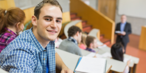 Fotolia Smiling Male With Students And Teacher At Lecture Hall C Wavebreak Media Micro 5 7558243 L